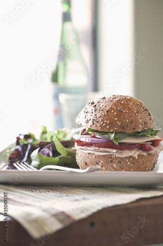 Sandwich and salad on plate