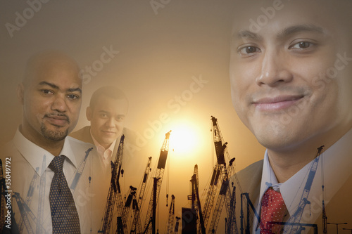 Businessman with silhouettes of cranes in background