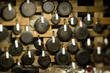 Array of saute and frying pans hanging on wall