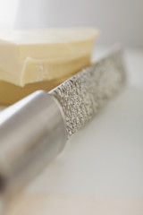 Close up of cheese and grater