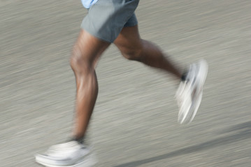 Blurred runner's legs running