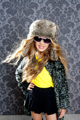 children fashion blond girl with fur winter coat and hat