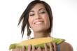 Beautiful Brunette holds a corn stalk