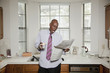 African American businessman reading newspaper in morning