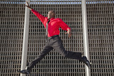 African American businessman jumping in mid-air