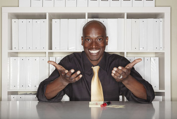 African American businessman gesturing welcome