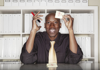 African American businessman holding dollar sign