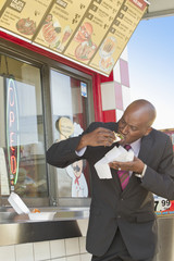 African American businessman eating lunch
