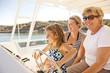Family enjoying boat on lake