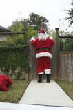 Santa peering over fence gate