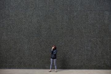 Korean woman standing in city sidewalk