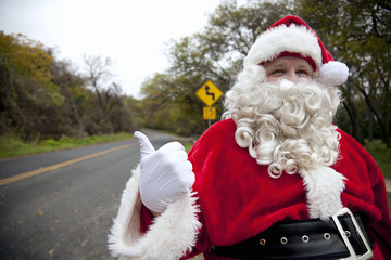 Santa hitchhiking at roadside