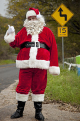 Santa hitchhiking at roadside