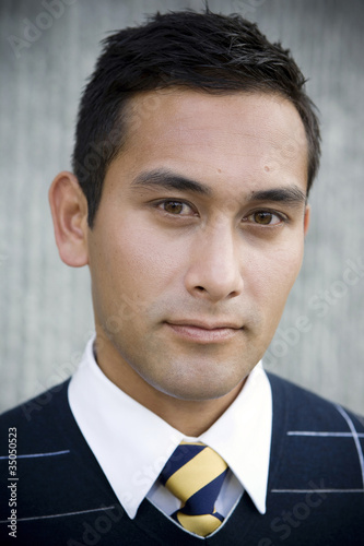 Serious mixed race businessman