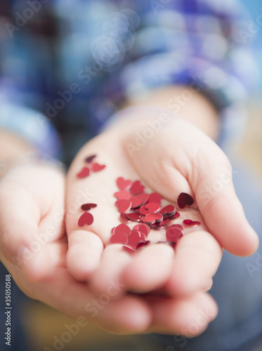 African American girl holding handful of hearts