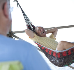 Caucasian man laying in hammock