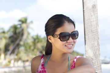 Smiling Chinese woman wearing sunglasses