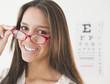 Hispanic teenage girl having eye exam