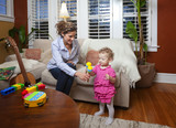 Hispanic mother playing maracas with daughter