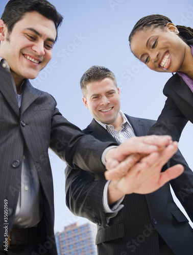 Business people clasping hands together