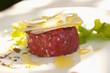 Parmesan cheese atop steak tartare
