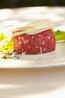 Parmesan cheese atop steak tartare