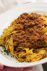 Close up of meat ragu over noodles