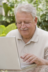 Senior Chilean man typing on laptop