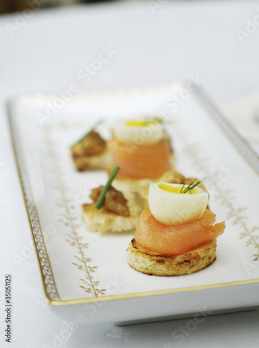 Close up of salmon and quail egg appetizers
