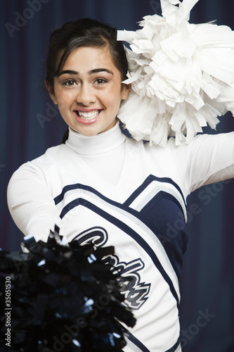 Filipino cheerleader with pompoms in uniform