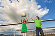 Children holding globe near solar panels