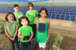 Children standing together in solar panel field