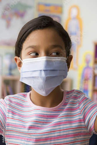 Hispanic girl wearing surgical mask