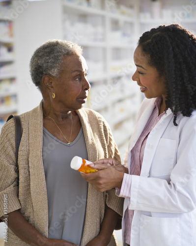 Pharmacist explaining medication to woman