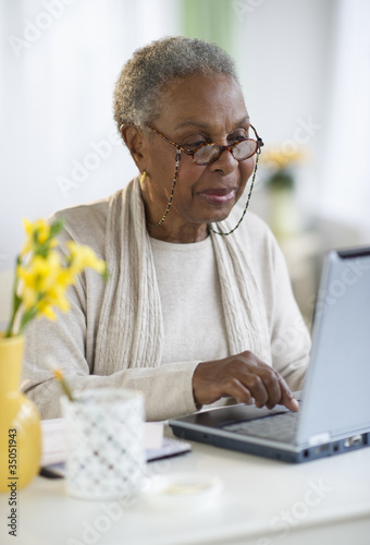 Black woman using laptop