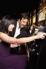 Couple enjoying gambling in casino