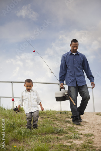 Father and son going fishing together