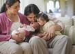 Hispanic family comforting crying newborn baby girl