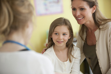 Mother and daughter with doctor in doctor's office