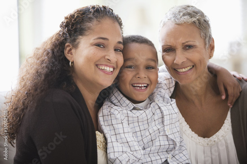 """Grandmother, mother and son smiling"""