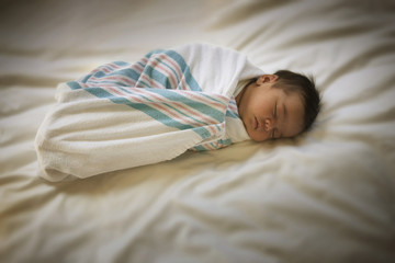 Sleeping newborn mixed race baby girl