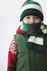 Caucasian boy in cap and scarf