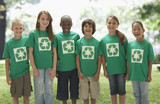 Children standing together in recycling t-shirts