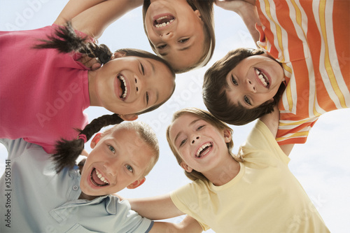 Smiling children huddling together