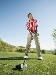 Black golfer preparing to swing golf club