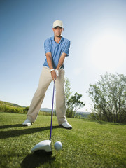 Caucasian golfer preparing to swing golf club