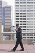 Hispanic businessman using cell phone in highrise rooftop