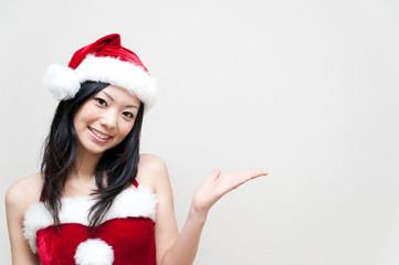 a portrait of attractive asian santa claus