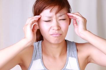 japanese woman woman suffers from headache