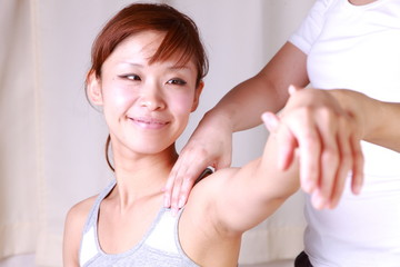 young japanese woman receives chiropractic